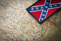 Historical flag of the south of the United States on the background of the USA map. View of the Historical flag of the south of the United States on the royalty free stock photo