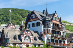 View on an historical German frame house with hill and vineyards in the background Stock Photography