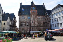 View of historical Town Hall with historical buildings, Marburg. View of historical Town Hall (Rathaus) with historical buildings and morning market Stock Photography