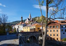 Stone bridge over Mur river. Murau, Styria, Austria. View of the historical town of Murau. Stone bridge over Mur river. Murau, Styria, Austria Royalty Free Stock Photos