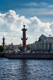 View of historical Vasilievsky island with red Rostral column in Stock Photo
