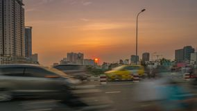 View of Ho Chi Minh City traffic at sunset. Ho Chi Minh City, Vietnam - December 9th 2019: Time lapse view of Ho Chi Minh City traffic at sunset stock video footage