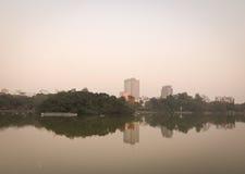 View of Hoan Kiem lake in Hanoi downtown Stock Photos