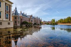 The Hofvijver court pond in front of the buildings of the Dutch parliament, The Hague, Netherlands. A view on the Hofvijver court pond and the Dutch parliament royalty free stock photos