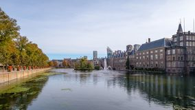 The Hofvijver court pond in front of the buildings of the Dutch parliament, The Hague, Netherlands. A view on the Hofvijver court pond and the Dutch parliament stock image