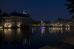View on the Hofvijver in the Hague. View on the Hofvijver with fountain at the Dutch Parliament Building 'het Binnenhof' in the Hague, the Netherlands at night royalty free stock image