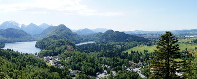View of Hohenschwangau Castle & Swan Lake from Neu. Bavaria from above. Picture was made from Neuschwanstein Castle.  Schwansee behind it on the right (east Stock Photography