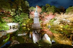 View of the Hojo Garden at Chion-in Buddhist temple. Pond, bridge, lantern and lots of green plants and trees in autumn evening stock photos