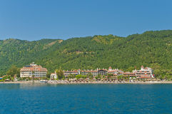 View of holiday resorts and beach from sea Stock Images