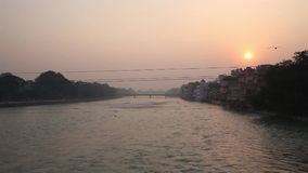 View of  holy ghats. A view of  holy ghats of Varanasi with a boatman sailing stock footage