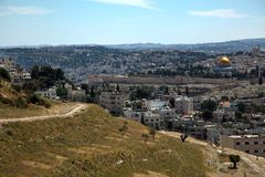 Mount of Olives and Dome of the Rock. A view at the holy Muslim Dome of the Rock and Al-Aqsa mosque behind the surrounding wall of the old city of Jerusalem. On Stock Photography