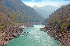 The river Ganges in India at Laxman Jhula. View at The holy river Ganges in India at Laxman Jhula Royalty Free Stock Photo