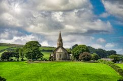 A view of Holy Trinity church, Bardsea Cumbria, England. stock photography