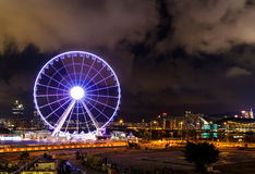 View in Hong Kong in the evening. Observation wheel in Hong Kong at night stock images