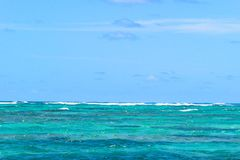 View of horizon line with summer sky and blue turquoise ocean water. Royalty Free Stock Photo