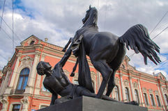 View of Horse tamers monument by Peter Klodt on Anichkov Bridge in Saint-Petersburg Russia. Popular touristic landmark. Royalty Free Stock Images