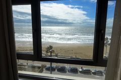 View of a hotel room window of the beach and sea of Cadiz in Andalusia in Spain royalty free stock photography
