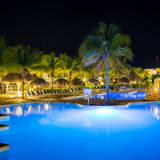 View of hotel and swimming pool at night Royalty Free Stock Image