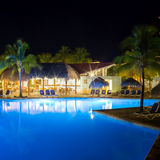 View of hotel and swimming pool at night royalty free stock photo