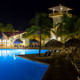 View of hotel and swimming pool at night Stock Photos
