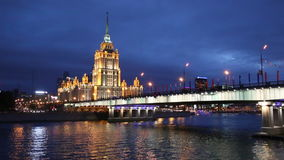 View of the hotel Ukraine, Novoarbatsky bridge, Moscow river at night, Moscow,. Russi stock video