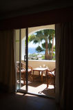 View from the hotel window at the sea and palm tre Royalty Free Stock Photography