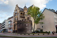 View of house with ancient roman tower. In downtown of Cologne city, Germany Stock Photo
