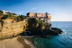 View of a house on a cliff and a small cove at Table Rock Beach, Royalty Free Stock Images