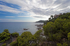 View of the house on the coast of Costa Brava at sunset Royalty Free Stock Photos