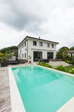 View of house, external with garden and pool Royalty Free Stock Photo