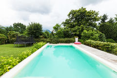 View of house, external with garden and pool Stock Image