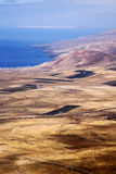 View from and house field coastline. View from the top in lanzarote spain africa and house field coastline Royalty Free Stock Photos