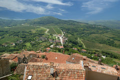View of the house with red roofs and the valley Royalty Free Stock Photography