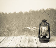 View on house in snowy winter forest from dark wooden gangway, t Stock Photography