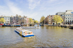View on houseboats, Amsterdam, the Netherlands. View on the houseboats with cruiseboat in Amsterdam the Netherlands Stock Photo