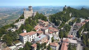 The view of the houses and apartments in San Marino. Where there are narrow streets and the view of the mountains on the back stock video footage