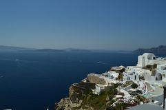 View Of Houses With Blue Vaulted Rooftop With View Of Bluish Aegean Sea In Oia Town Santorini Island. Architecture, Landscapes, Tr stock photography