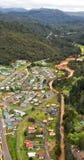 View of houses and buildings Queenstown Tasmania. Queenstown, Tasmania, Australia, Ocotber 10, 2013: Aerial view of houses and buildings in the small west coast stock images