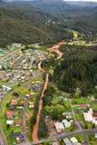 View of houses and buildings Queenstown Tasmania. Queenstown, Tasmania, Australia, Ocotber 10, 2013: Aerial view of houses and buildings in the small west coast royalty free stock images