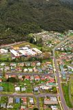 View of houses and buildings Queenstown Tasmania. Queenstown, Tasmania, Australia, Ocotber 10, 2013: Aerial view of houses and buildings in the small west coast stock photo