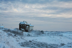 View of the houses covered with snow close to the dunes, Netherl Stock Photography