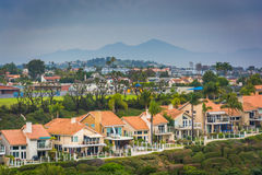 View of houses and distant mountains from Hilltop Park  Stock Photos