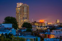 View of houses and the Domino Sugars Factory at night in Federal Hill, Baltimore, Maryland stock photo