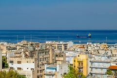 View of the Houses in the Greek Town of Patras and the Sea With the Cargo Ship royalty free stock image