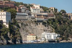 View of houses and hotels on the cliffs in Sorrento. Gulf of Naples, Campania. Italy royalty free stock image