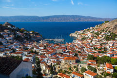View of houses Hydra island on a Sunny day. Greece Royalty Free Stock Images