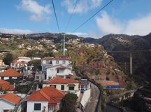View of the of houses and market gardens of funchal from the cable car running up the mountain to monte with road bridge and. Mountains stock photos