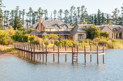 View of houses next to a dam with jetty Royalty Free Stock Photo
