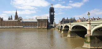 View of the Houses of Parliament and Westminster bridge on the north end of the River Thames with Big Ben being in the distance. View westminster houses royalty free stock image