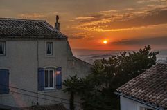 View of houses at sunrise in the village of Châteauneuf-de-Gadagne. Stock Image